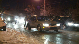 HD2009-11-24-20 snowstorm people pushing cars hopless spin Stock Video Footage
