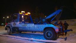 HD2009-11-24-22 snowstorm tow truck jacknifed semi Stock Video Footage
