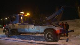 HD2009-11-24-22 snowstorm tow truck jacknifed semi Footage