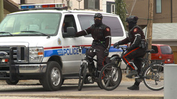 HD2009-10-5-6 police on bikes with van Stock Video Footage