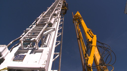 HD2009-9-17-9 drill rig arm hi angle Stock Video Footage