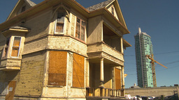 HD2009-9-31-5 boarded old house and new condo tower Stock Video Footage