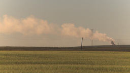 HD2009-9-31-11 pollution exhaust stack over field Z Stock Video Footage