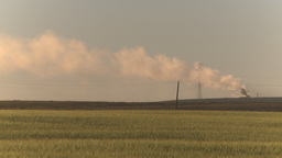 HD2009-9-31-11 pollution exhaust stack over field Z Footage