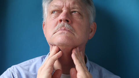 Man Checking His Painful Lymph Nodes stock footage