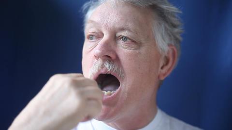 Older Man Brushing His Teeth stock footage