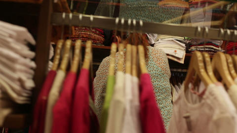woman chooses clothes in a shop Live Action