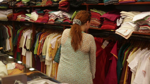 woman chooses clothes in a shop Footage