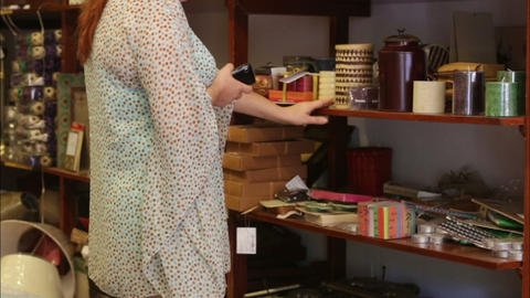 woman chooses decorative accessories in the store Live Action