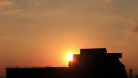 Sunrise from behind the Silhouette Building Time L Footage