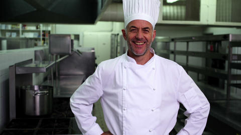 Head Chef Smiling At Camera With Hands On Hips stock footage