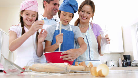 Happy family baking together Footage