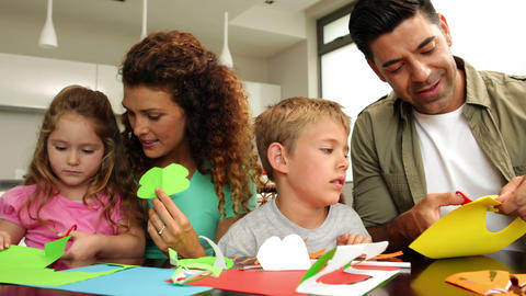 Happy parents and children doing arts and crafts a Footage