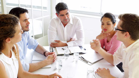 Business people listening to colleague during meeting Footage
