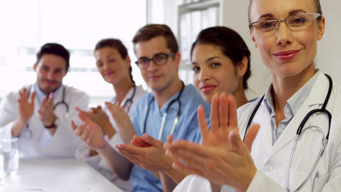 Medical team clapping at camera Footage