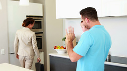 Working mother waving goodbye to house husband and Footage