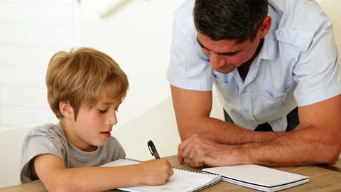 Father helping his son with his homework Footage