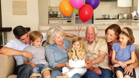 Extended family celebrating little girls birthday  Footage