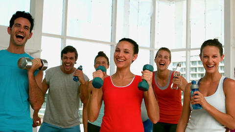 Fitness class smiling at camera with exercise balls Footage
