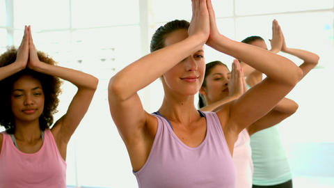 Yoga class standing in tree pose Footage