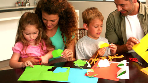 Parents and children making paper shapes together  Footage
