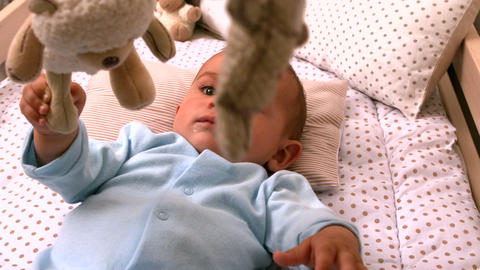 Baby Playing With Mobile In His Crib stock footage