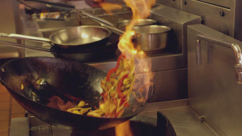 Chef Tossing Flaming Stir Fry stock footage