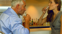 Business colleagues drinking a shot together Footage