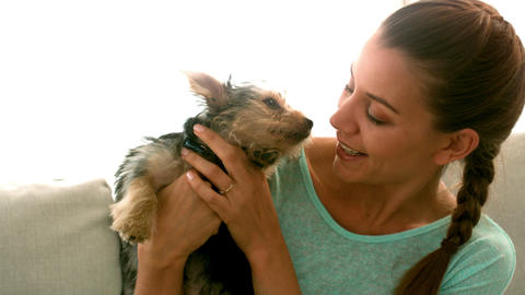 Woman Holding Her Puppy stock footage