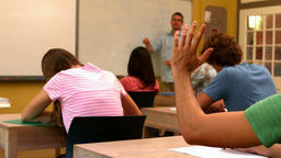 Student putting up his hand in class Footage