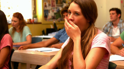 Student yawning in classroom Live Action