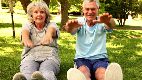Retired Couple Exercising Together Outside stock footage