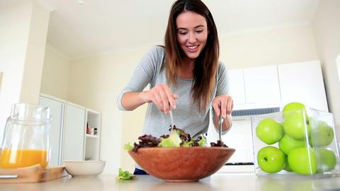 Pretty brunette preparing a healthy salad Footage