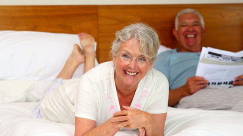 Senior Couple Relaxing On Bed stock footage
