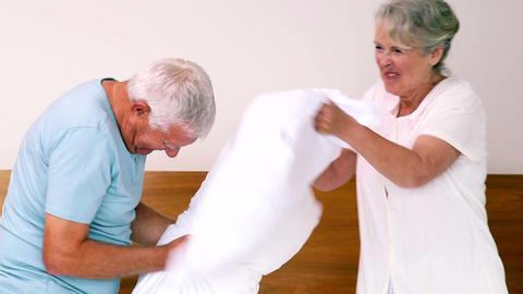 Senior couple having a pillow fight Live Action