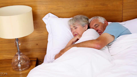Senior Couple Sleeping In Bed stock footage