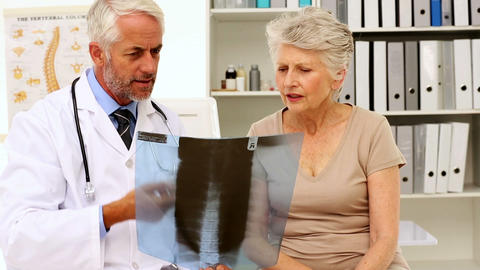 Doctor explaining an xray to patient Footage