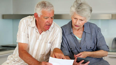 Senior Couple Organizing Their Bills stock footage