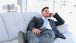 Businessman relaxing on the sofa Live Action