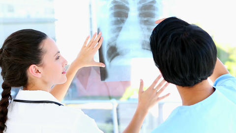 Doctor and nurse discussing xray Footage