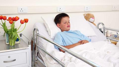 Little sick boy sleeping in bed Footage