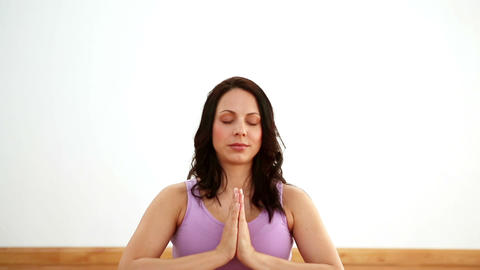 Pregnant woman meditating on exercise mat Footage
