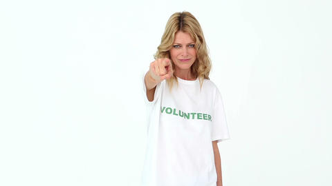 Pretty volunteer pointing to camera Footage