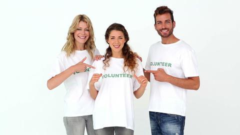 Team of volunteers smiling at camera Footage