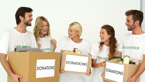 Team of volunteers holding donation boxes and cheering Footage