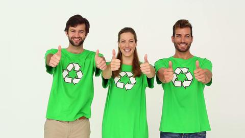 Team of environmental activists smiling at camera showing thumbs up Footage