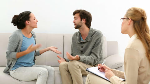 Young couple arguing while therapist takes notes Footage