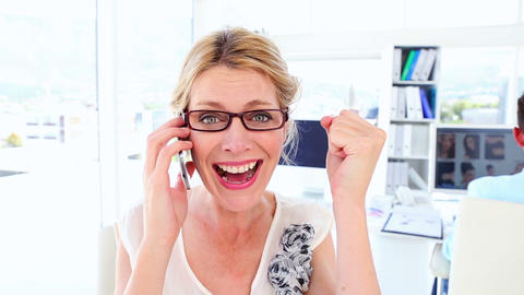 Excited businesswoman getting good news over the phone Footage