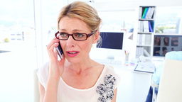 Disappointed businesswoman on the phone Footage