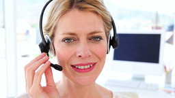 Happy call center agent on a call Live Action